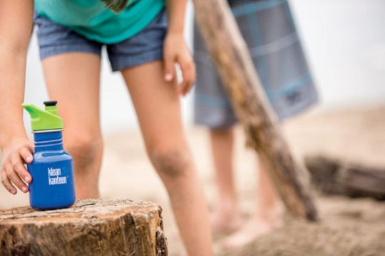 K12CPPS-CW-LS-Girl-Putting-Bottle-on-Stump-1-600x400-1605013791.jpg